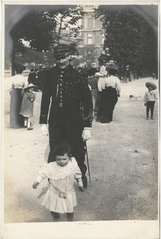 A man in uniform chases a young child