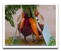 @lisa.atlas-nice fall harvest centerpiece.  I'd add different carrot and beet varieties for varied colors and maybe some rainbow chard with their colorful stalks.  Float a pomegranate at bottom and add a ribbon around vase and solid fabric or paper square under to set off. #centerpiece, #vegetables, #Fall