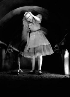 Charlotte Henry in Alice in Wonderland (1933, dir. Norman Z. McLeod) 'Curiouser and curiouser!' cried Alice (she was so much surprised, that for the moment she quite forgot how to speak good English); Good-bye, feet!' (for when she looked down at her...