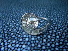 Really unique baguette diamond engagement ring
