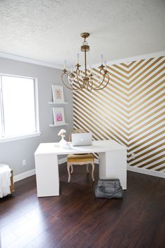 Glamorous home office with fabulous hand painted white and gold chevron accent wall! A white Ikea desk sits at an angle in the corner of the room, it pairs with a vintage cane backed chair spray painted gold. Home Decor Inspiration, Interior, Home, Chevron Accent Walls, House Interior, Gold Walls, Interior Design, Striped Walls, New Room