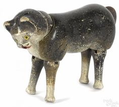 Schoenhut painted wood cat with a two-piece head, an open mouth, and painted eyes, 5'' l. - Price Estimate: $800 - $1000