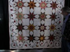 Beautiful feathered star quilt