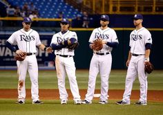 Infielders (L - R) Evan Longoria #3, Yunel Escobar #11, James Loney #21 and Ben Zobrist #18 of the Tampa Bay Rays relax during a pitching change against the Seattle Mariners during the game at Tropicana Field on August 13, 2013 in St. Petersburg, Florida. (Photo by J. Meric/Getty Images)