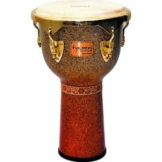 """Tycoon Percussion 12 Inch Master Platinum Sunrise Djembe by Tycoon Percussion. $339.00. Tycoon Percussion's Master Platinum Series Djembe is constructed of carefully selected aged Siam Oak with handpicked premium quality 12"""" goat skin heads for rich bass and crisp, high slaps.  Multiple layers of super high gloss lacquer polishing give a mirrored look to three eye catching sparkle fade finishes that pop on stage.  Deep and powerful tones make it perfect for live or drum circ..."""
