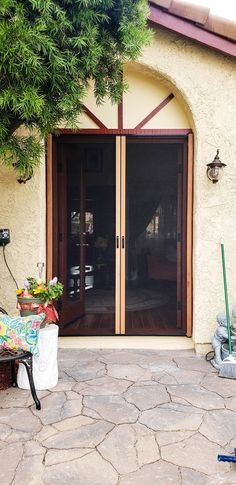 We installed Mahogany Wood Veneer Double Retractable Screen Doors on a set of French front doors in Simi Valley, California! For wooden front doors in need of Retractable Screens to match, call the Classic team! Visit www.chiproducts.com to see all of the many features we offer for you to customize your Retractable Screens, or call (866) 567-0400 for a free estimate! Retractable Screen Door, Pull Bar, Wooden Front Doors, Simi Valley, Screen Doors, Wood Veneer, French Doors, Garage Doors