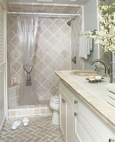 Small Bathroom 9: Luxurious Tiles. note corner bench, basket-weave floor & travertine tiles on shower walls.