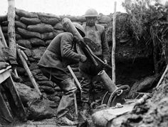 American soldiers, members of Maryland's 117th Trench Mortar Battery, operating a trench mortar. This gun and crew kept up a continuous fire...