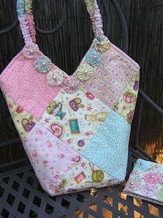 a yo-yo adorned sewing bag with matching needlecase