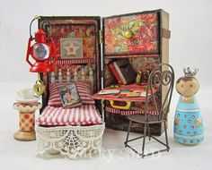 Tiny Traveler. A painted peg doll with a miniature steamer trunk/home away from home (K.Batsel)