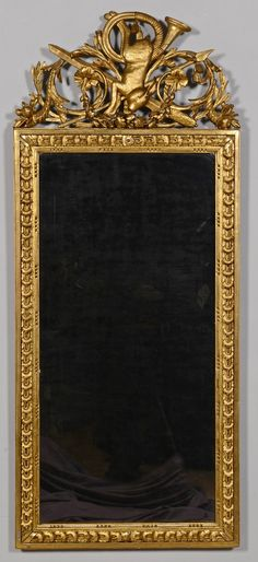 """Huntsman's Trophee Mirror. Carved and Gilt Wood and Mirrored Glass. French (Attributed). Circa Early to Mid-19th Century. 56"""" x 23-1/4"""" x 1-3/8""""."""