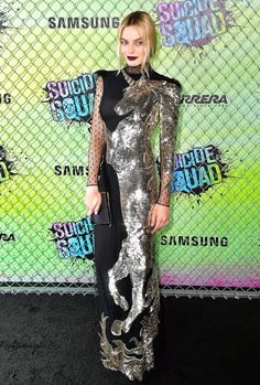 Margot Robbie went dark at the Suicide Squad premiere in NYC. She donned a black Alexander McQueen gown, which was covered from neck to toe in an embellished gold unicorn design. She paired the dress with a black Jimmy Choo clutch. See other outfits from her Suicide Squad press tour!