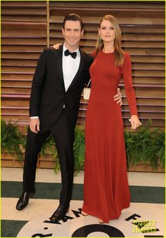 Adam Levine holds his fiancee Behati Prinsloo close as they hit up the 2014 Vanity Fair Oscar Party held during the 2014 Oscars on Sunday night (March 2) in West Hollywood, Calif. Adam is wearing head-to-toe Salvatore Ferragamo. Behati is carrying a Salvatore Ferragamo clutch.