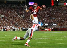 Richard Mullaney #16 of the Alabama Crimson Tide leaps over Kendarius Webster #15 of the Mississippi Rebels on the way to a touchdown at Bryant-Denny Stadium on September 19, 2015 in Tuscaloosa, Alabama. (Sept. 18, 2015 - Source: Kevin C. Cox/Getty Images North America)