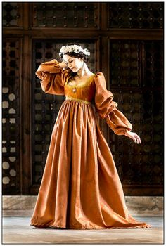 Is this even legit? I don't even know. It's romantical, though! Orange italian renaissance gown by FashionCostume on Etsy, €290.00
