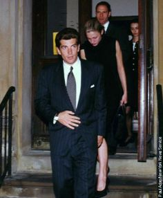 John Kennedy Jr. with wife Carolyn Bessette are spotted leaving St. Thomas Moore Church after attending a memorial for Jackie Onassis on the first anniversary of her death in New York City