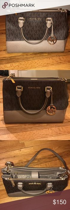 Michael Kors bag Adorable Michael Kors bag - used less than 5 times - in amazing condition! Comes with crossbody strap, has 2 zipper pockets (front & back) & large inside space Michael Kors Bags