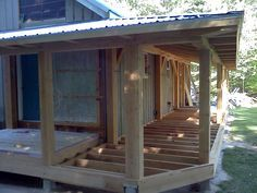 This custom designed and crafted timber frame farmers porch adds to a beautiful backyard setting providing covered dining and entertaining space. House Deck, House With Porch, Mobile Home Porch, Farmers Porch, Porch Kits, Porch Ideas, Pergola, Building A Porch, Screened In Porch