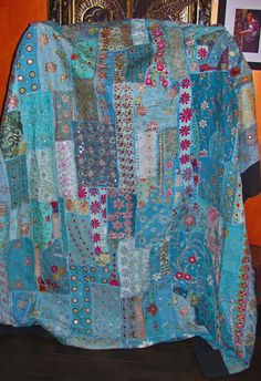 Fair Trade Pale Blue and Teal Handmade Gujarat Patchwork Tapestry Bedspread from India. A combination of recycled antique saris and wedding gowns sewn with Zardosi embroidery, Kutch crochet, and Gujarati mirror, jewel and sequin work.
