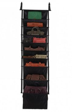 Slingo Handbag Hanging Organizer by Umbra. A new cure for disorganization, this hanging polyester storage compartment had 9 roomy pockets, perfect for mags, bags, and other accessories.