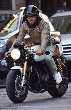 Ryan Reynolds looks stylish in leather jacket and cargo pants during motorbike ride Cruise control! The and father-to-be Ryan Reynolds jumped behind the wheel of his motorcycle and enjoyed a leisurely spin Ducati Cafe Racer, Cafe Racer Bikes, Cafe Racer Motorcycle, Motorcycle Style, Motorcycle Gear, Motorcycle Jackets, Estilo Cafe Racer, Cafe Racer Style, Triumph Motorcycles