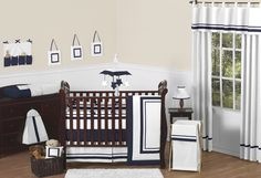 Sweet Jojo Designs Hotel White & Navy 9-Piece Baby Crib Bedding Set. This is his bedroom set, minus a few of those unnecessary accessories.