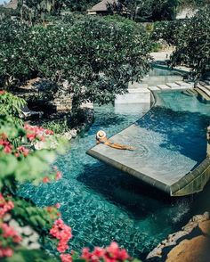We are dreaming of this pool, the only thing that would make this better is a Fin Fun mermaid tail.