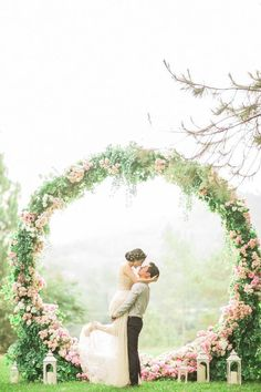 11 More Giant Wedding Wreaths: The Hottest Wedding Trend: #5. Super romantic pink wedding wreath with candle lanterns around