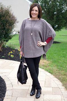 Gray fringe poncho, burgundy t-shirt, black skinny pant, black ankle boot