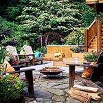 This outdoor space has everything!  Great deck, seating, greenery, potted flowers, stone walkway and a fire-pit!  perfect for entertaining or alone reading a book!