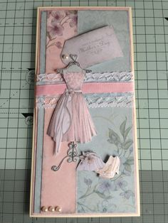 DL DoCrafts Bellisima collection - the peachy background is made from the packaging of the kit! The lace and ribbons work well, very pretty card.