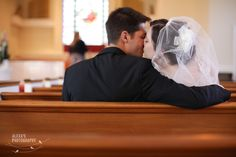 Kissing in the pew....or take a picture with bride and groom in pews and bridal party and family