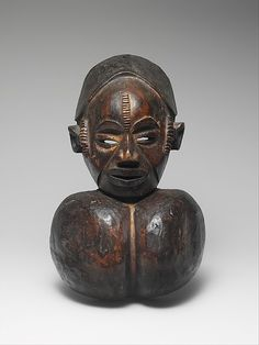 Mask: Female with Goiter Date:19th–20th century Geography:Nigeria, Benue River Valley region Culture:Okpoto peoples, Idoma group Medium:Wood, pigment Dimensions:H.14 7/8 x W. 9 3/8 x D. 5 1/4 in. (37.8 x 23.8 x 13.3 cm)