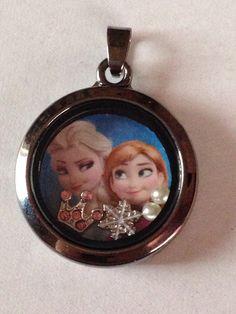 Disney's Frozen Elsa And Anna Floating Charm Locket by KeepCalmAndBeadIt on Etsy https://www.etsy.com/listing/215170838/disneys-frozen-elsa-and-anna-floating