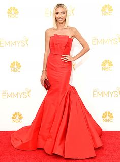 Giuliana Rancic: 2014 Emmys The E! News host wore a fitted red Gustavo Cadile gown with folded detail at the neck and a voluminous skirt with Forevermark jewelry.