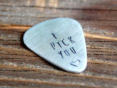 I Pick You Guitar Pick - Hand Stamped - Romantic Guitar Pick - Gift for Musician - Aluminum Guitar Pick - Stamped Pick by FiberAndShine on Etsy https://www.etsy.com/listing/231140507/i-pick-you-guitar-pick-hand-stamped