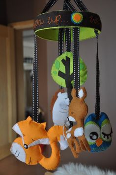woodland animal nursery mobile - i like the use of thick ribbon to hang the animals