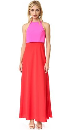 Jill Jill Stuart Two Tone Gown | Two bright hues bring a bold pop to this Jill Jill Stuart maxi dress. The bodice overlay has a split back, framing the hook-and-eye keyhole. Hidden back zip. Lined. Fabric: Crepe. 100% polyester. Dry clean. Imported, China. Measurements |  Length: 60in / 152.5cm, from shoulder Measurements from size 4