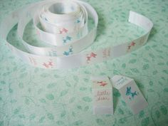Make your own labels/tags by using iron ons you print - ironing onto ribbon. (littledeartracks.blogspot.com)