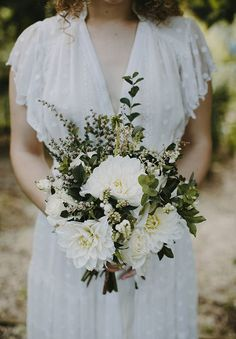 EMILY + LLOYD // #flowers #bouquet #bride #wedding #white #green #inspiration