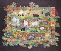wool felted sheep on quilt! How cool!