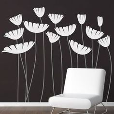 "Whether beside the doorway or adorning an accent wall, this floral decal fills your home with organic intrigue and eye-catching style. Product: Wall decalConstruction Material: VinylColor: White and grayFeatures: RemovableFloral motifDimensions: 60"" H x 70"" W"