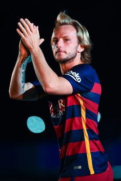 Ivan Rakitic of FC Barcelona waves during the team official presentation ahead of the Joan Gamper trophy match at Camp Nou on August 5, 2015 in Barcelona, Catalonia.