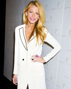 Stars at New York Fashion Week  Blake Lively  Gossip Girl's Blake Lively took in Noon by Noor in a white tuxedo dress. Magenta lips