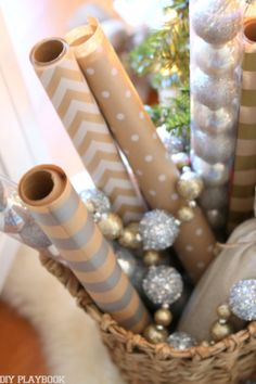 Add a wicker basket next to your Christmas tree and fill it with pretty wrapping paper for instant access and holiday decor!