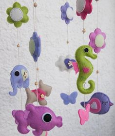 Felt animals baby mobile with flowers and butterflies for a girl - made to order. $85.00, via Etsy.