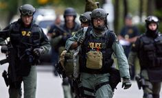 A tactical team exits the scene on Thursday evening where Newport News Police faced a standoff with a federal fugitive. (Kaitlin McKeown / July 12, 2012)