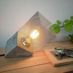 Industrial lighting table lamp, Concrete tilted table lamp, Metal lamp shade, Edison lamp, Industrial decor, Edison bulb, Industrial Gifts Model: Concrete cube VI This is a lamp made by hand with cement, a basic cube-shaped design. Make this table lamp will make your home more modern.