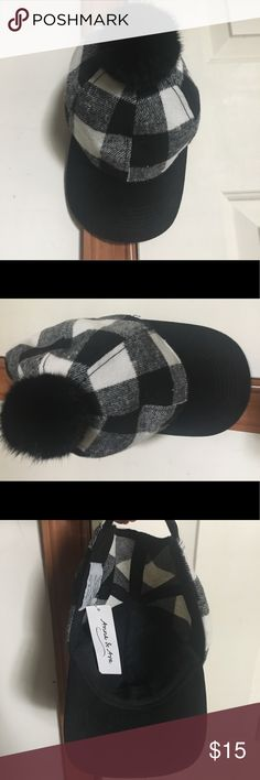 Anna & Ava Poly/Wool Pom Pom Plaid Baseball Cap OS NWT Black/Ivoy Plaid baseball cap with faux pom top! Beautiful One Size fits all adjustable velcro head strap. Never been worn. 95 % Polyester/5% Wool. Bill may  have lint as it snores in picture,but not permanent easily removable. Super cute and fun addition for your winter wear. Anna & Ava Accessories Hats