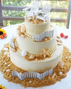 "Beachy Cake with graham cracker crumb or brown sugar ""sand"" and dollhouse-size Adirondak chairs and fencing"
